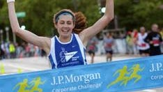 Yelena Nanaziashvili of the Principal Financial Group wins the women's title at the JPMorgan Chase Corporate Challenge in Chicago in 2013.