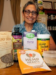 New Mexico medical cannabis patient consultant Hilda Luz Chavez is seen with legal hemp products used as a dietary supplement.