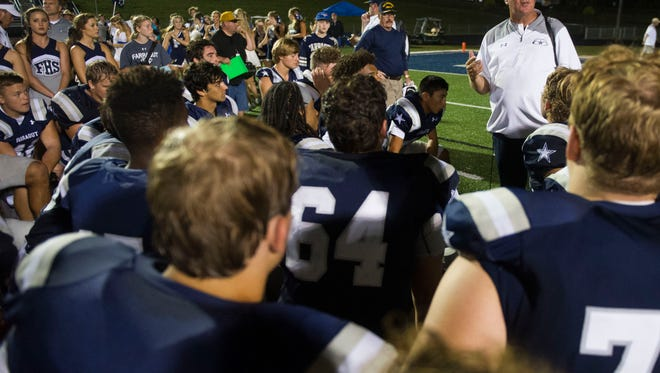 Farragut coach Eddie Courtney talks to the team after its 33-10 win against Morristown West on Thursday, Aug. 31, 2017.