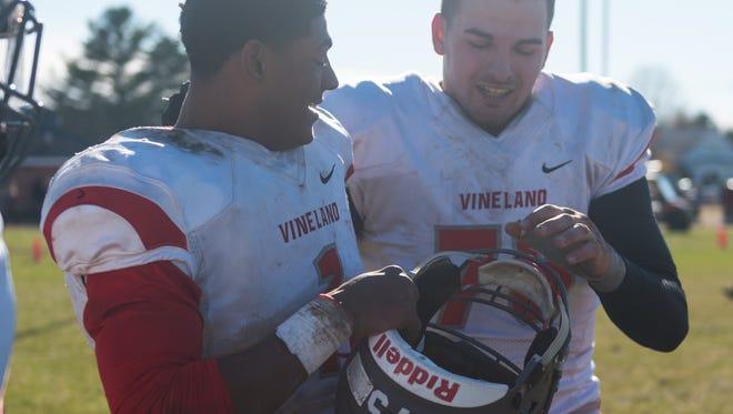 Vineland quarterback Isaih Pacheco (1) and lineman Noah Sansalone (75) celebrate a win against Millville at John Barbose Stadium on Thursday, November 23.