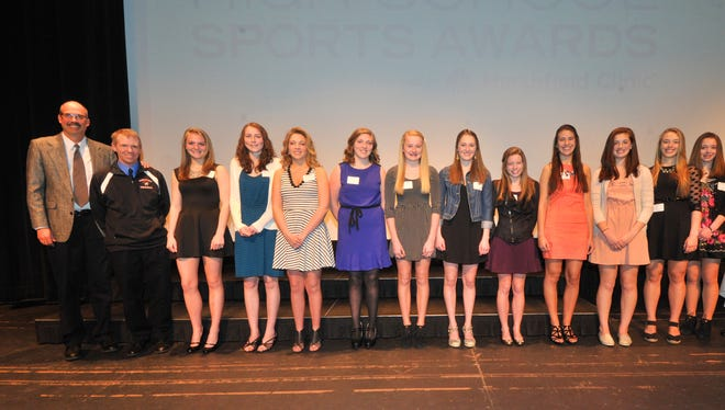 Ken Zoromski, far left, was the head coach of the Wausau East volleyball team from 2002 through 2014. In 2014, the team was named Girls Team of the Year at the Gannett Central Wisconsin Media sports award ceremony.