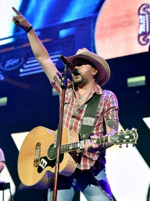 NASHVILLE, TN - NOVEMBER 12:  In this handout photo provided by The Country Rising Fund of The Community Foundation of Middle Tennessee, singer Jason Aldean performs onstage for the Country Rising Benefit Concert at Bridgestone Arena on November 12, 2017 in Nashville, Tennessee.  (Photo by John Shearer/Country Rising/Getty Images)