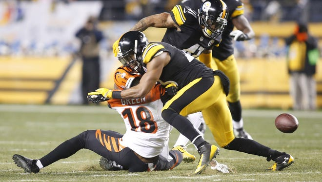 Steelers free safety Mike Mitchell (23) hits Bengals WR A.J. Green (18) causing Green to fumble during the fourth quarter at Heinz Field. Green was injured on the play.