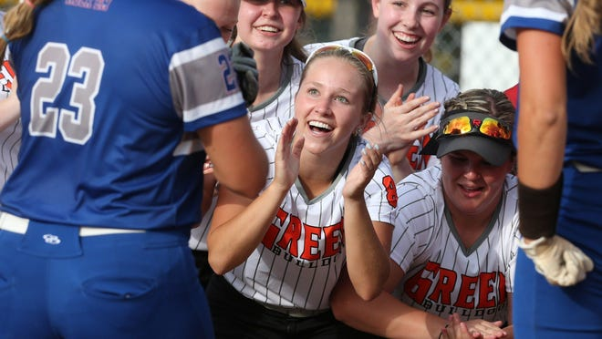 Lake's Emily Lippe (23) is welcomed home after her home run during the fourth inning of the Federal League All-Star Softball Game at Willig Field on Monday.