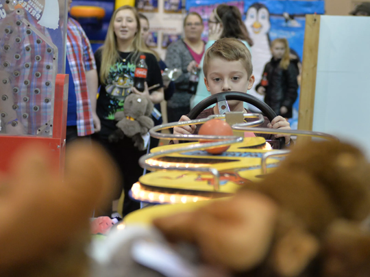 "Seven-year old Alex Breiner of Jonestown navigates ""The Sidewinder"" game at the 8th Annual Lebanon Rotary Club Bologna Fest & Winter Carnival held at the Lebanon Valley EXPO Center and Fairgrounds on Saturday."