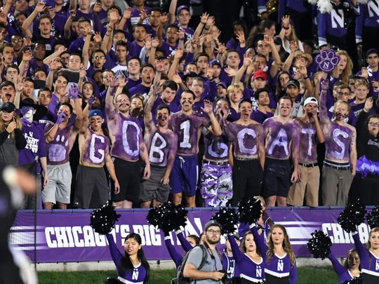 Northwestern Wildcats fans cheer for their team during