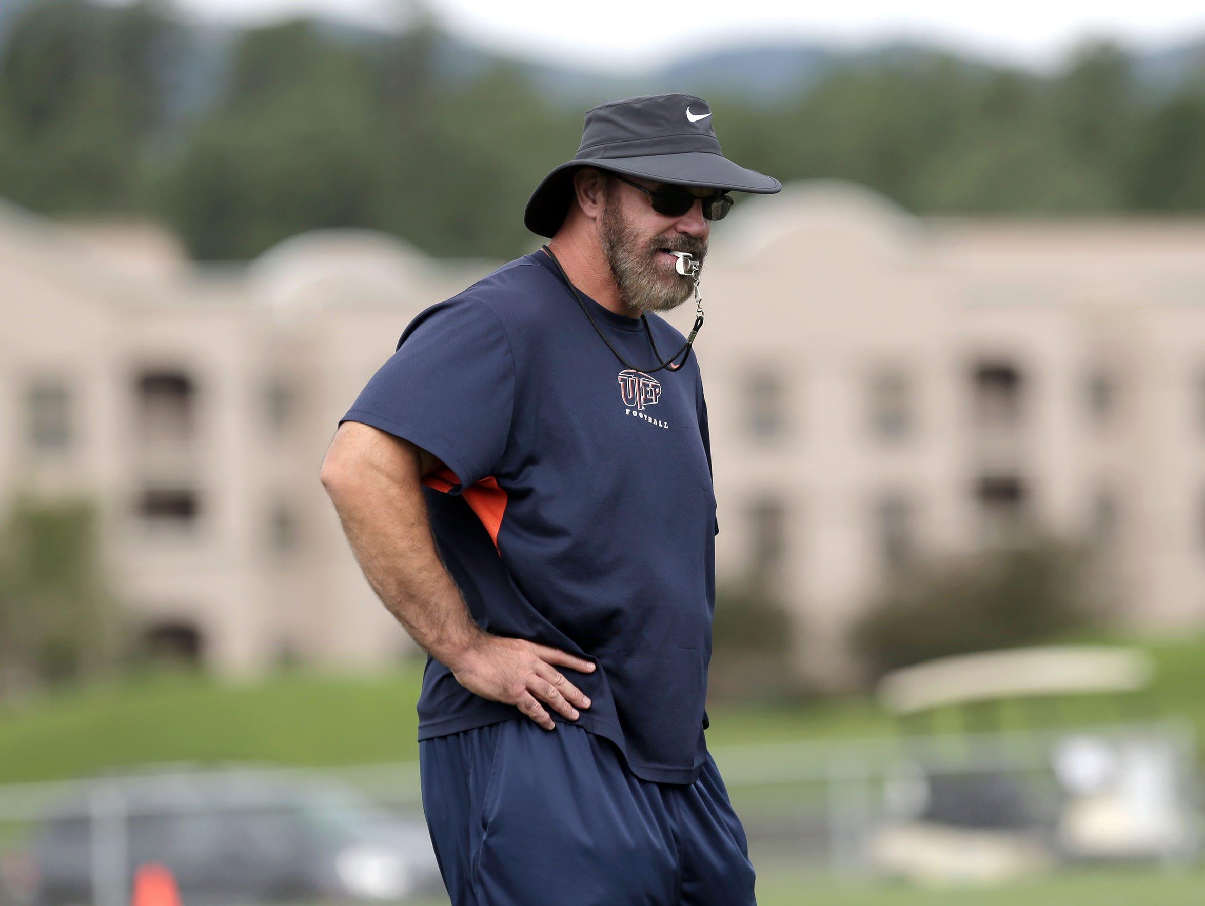 Head coach Sean Kugler patrols practice Wednesday August