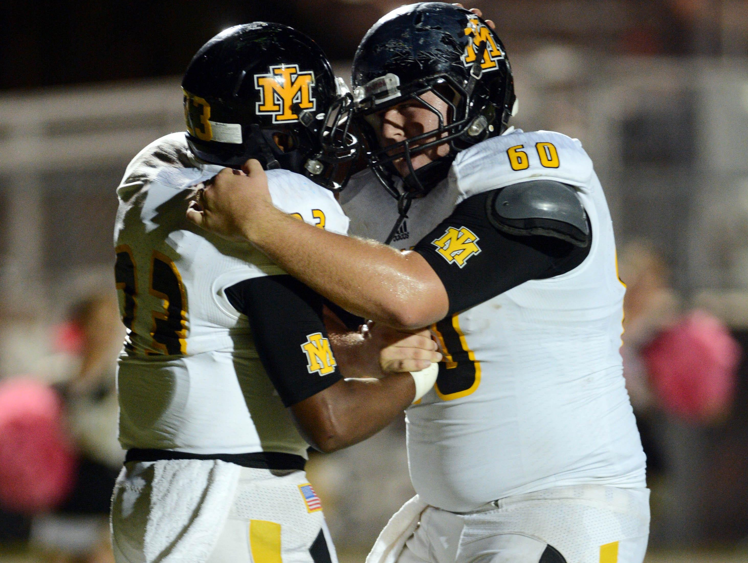Raleigh Barfield is congratulated after his TD by teammate Bailey Herring in last week's game.