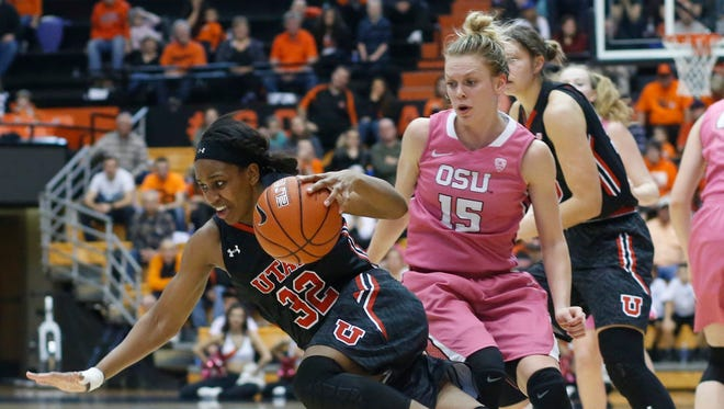 Utah's Tanaeya Boclair, front, is tripped up by Oregon State's Jamie Weisner, rear, in the second half of an NCAA college basketball game in Corvallis, Ore., on Sunday, Feb. 14, 2016. Oregon State won 72-53.