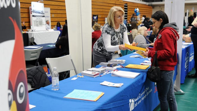 Joy Sherrick, with Ohio Means Jobs, left, gives Hannah Karshner information during a job expo Thursday at Ohio University Chillicothe.