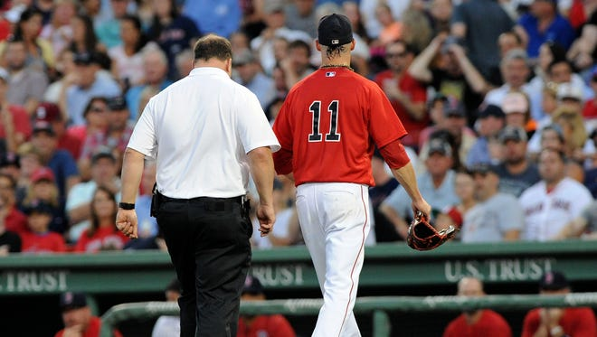 Boston Red Sox starting pitcher Clay Buchholz (11) leaves the game during the fourth inning against the New York Yankees at Fenway Park.