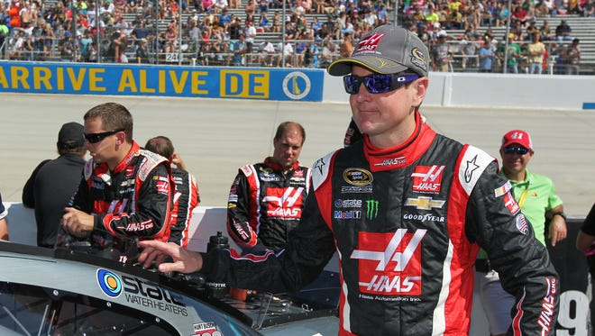 Kurt Busch stands by his car prior to the AAA 400 at Dover International Speedway on Sept. 28. He was accused of assaulting his ex-girlfriend in his motor home that weekend.
