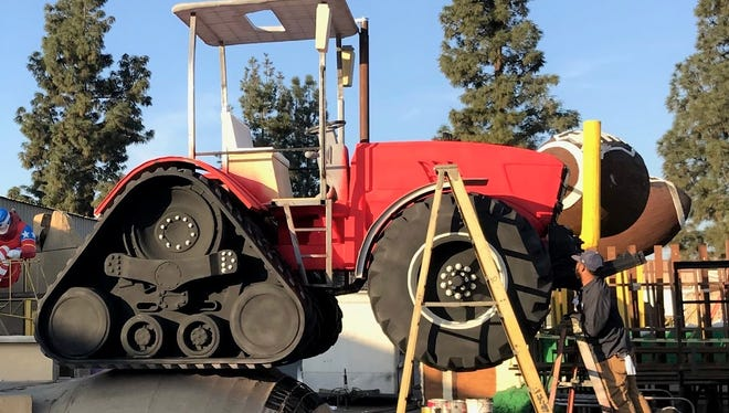 A tractor with tracks will be mounted on the front of the Ag PhD float appearing in the 2018 Rose Parade. The float is not a trailer, but a vehicle steered by a driver.