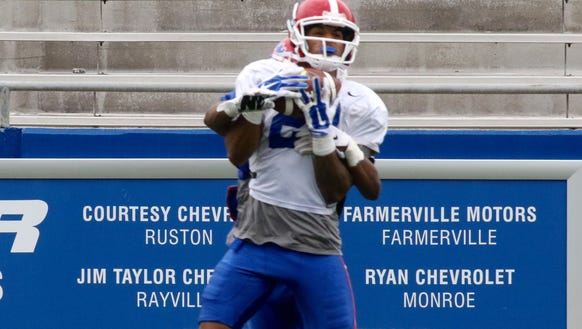 Louisiana Tech wide receiver Alfred Smith goes up to