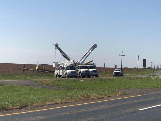 Crews work to repair downed power lines outside Stamford