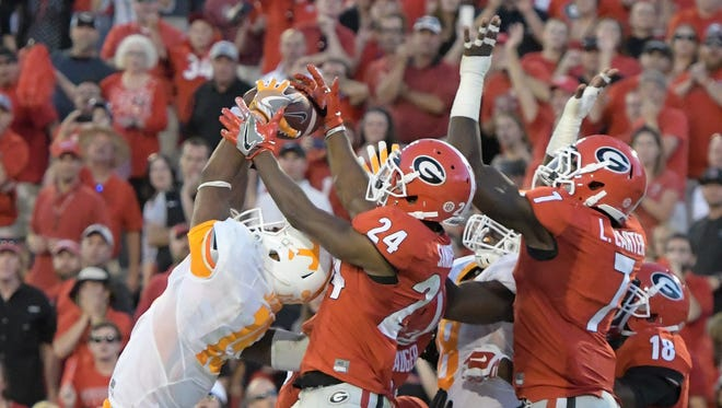 Tennessee Volunteers wide receiver Jauan Jennings hauls in the Hail Mary TD to beat Georgia.