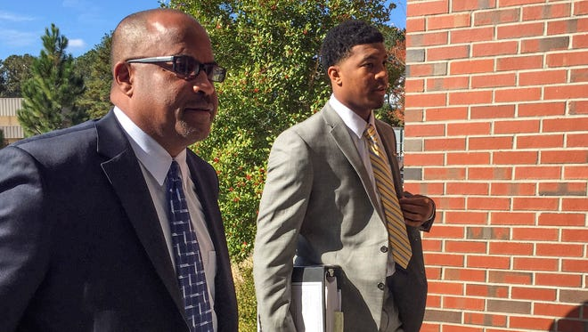 Jameis Winston, with his adviser David Cornwell, arrives for a Florida State code of conduct hearing this week.