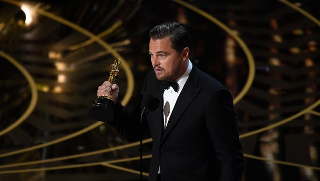 Leonardo DiCaprio accepts the Oscar for Best Actor for 'The Revenant' during the 88th annual Academy Awards.