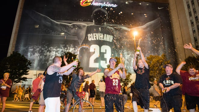 Fans react in downtown Cleveland after the Cavaliers won  the NBA Championship on June 19, 2016, in Oakland over the Golden State Warriors.
