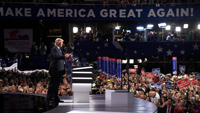 GOP presidential nominee Donald Trump takes the stage to introduce his wife Melania Trump during the 2016 Republican National Convention at Quicken Loans Arena.