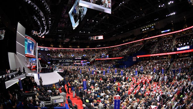 The roll call vote is conducted in the Quicken Loans Arena during the second day of the Republican National Convention in Cleveland, Tuesday, July 19, 2016. (AP Photo/Mark J. Terrill)