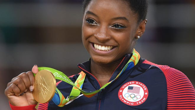 Simone Biles laves Rio with four gold medals and one bronze in gymnastics.