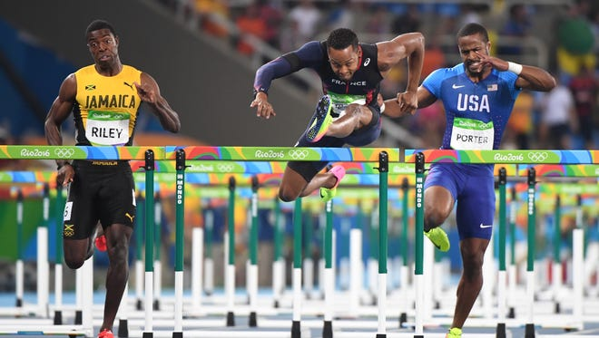 From left, Jamaica's Andrew Riley, France's Dimitri Bascou  and American Jeff Porter compete in the 110-meter hurdles semifinals. Porter, from Canton, did not advance.