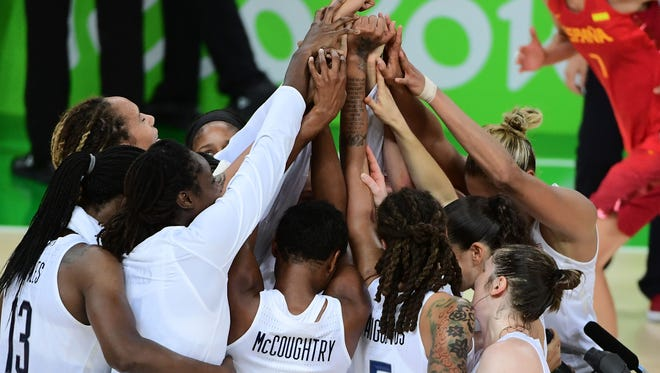 Players celebrate their basketball gold medal, one of 27 golds - and 61 overall - women won for the U.S.