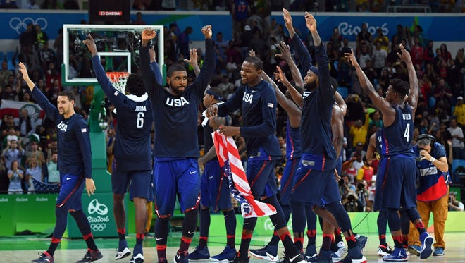 Team USA celebrates its rout of Serbia - and gold medal in men's basketball.