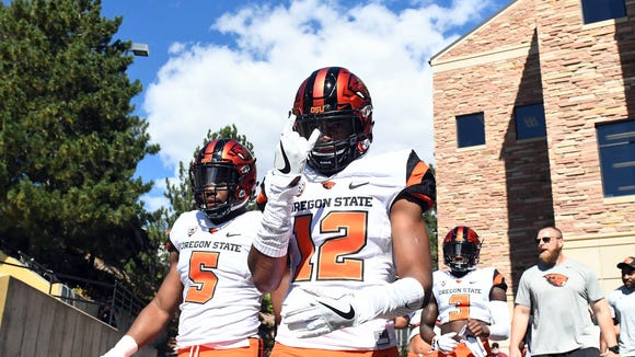 Oct 1, 2016; Boulder, CO, USA; Oregon State Beavers safety Kendall Hill  (12) and linebacker Kyle Haley (5) before the game against the Colorado Buffaloes at Folsom Field. Mandatory Credit: Ron Chenoy-USA TODAY Sports