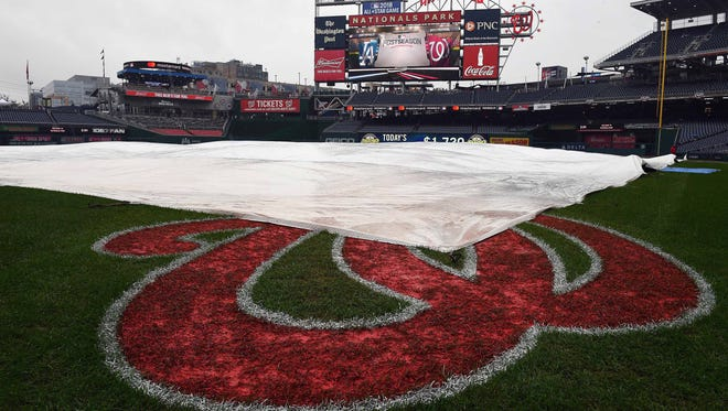 The tarp covers the infield at Nationals Park on Saturday.