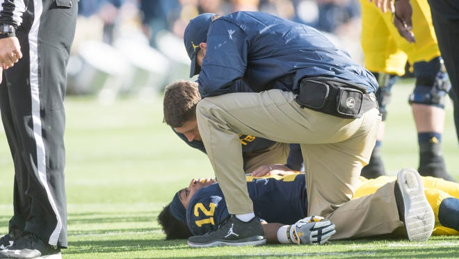 Michigan running back Chris Evans was injured in the first quarter after taking a hit to the head.