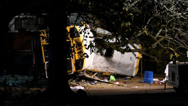 A school bus crashed into a tree in Chattanooga on Nov. 21, 2016, killing six elementary school children. The Tennessee Highway Patrol was using lights and scanners to reconstruct the scene on Talley Road.