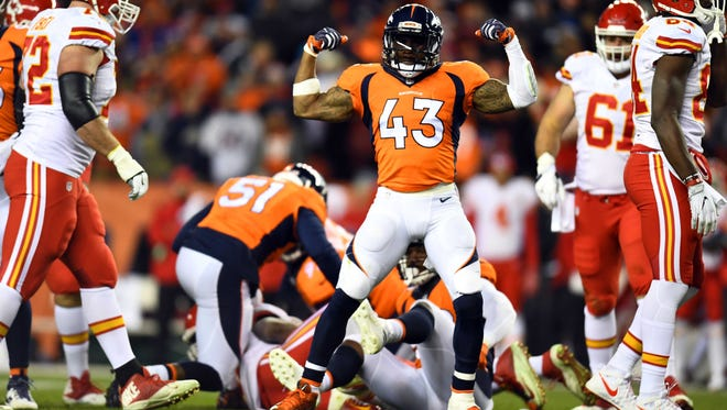 Nov 27, 2016; Denver, CO, USA; Denver Broncos strong safety T.J. Ward (43) reacts to a play in the first half against the Kansas City Chiefs at Sports Authority Field at Mile High.