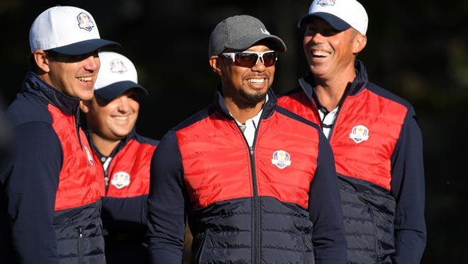 Team USA vice captain Tiger Woods shares a laugh with Team USA players Brooks Koepka , Patrick Reed and Matt Kuchar before their official photo on the 10th Fairway at Hazeltine National Golf Club ahead of the 41st Ryder Cup.