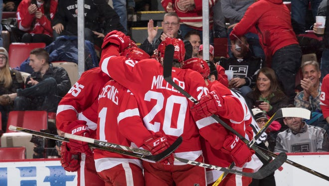 The Red Wings celebrate a goal by defenseman Mike Green in the first period.