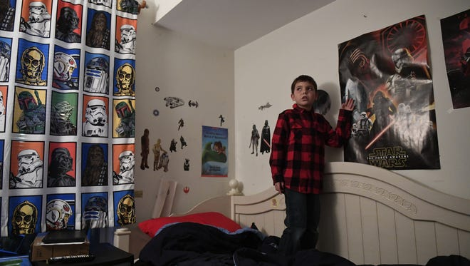 Joe Maldonado, 8, in his room that is filled with Star Wars. Maldonado was kicked out of Secaucus Cub Scout Pack 87 because he was born a girl.  Photographed in his home in Secaucus, NJ on Tuesday, December 13, 2016.