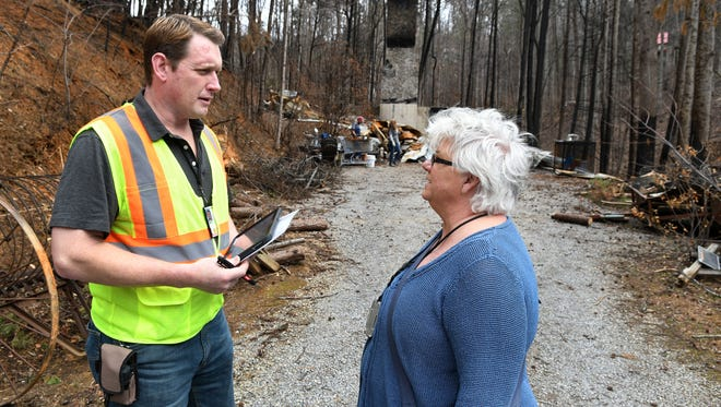 FEMA inspector Josef Pietraszuk, left, and FEMA regional external affairs officer Bettina Hutchings talk before beginning the inspection of the burned home of Bob and Stephanie Sweeney on Jan. 12, 2017. Their home is located at 1102 Hemlock Hollow Road in Gatlinburg.