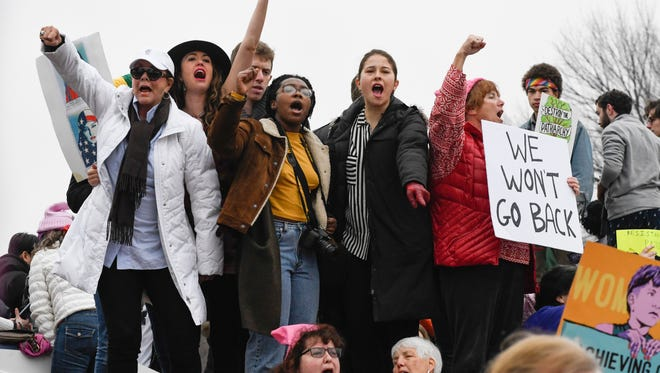 Protestors chat anti-Trump slogans during the Women's March on Washington in Washington, DC on Jan. 21, 2017, one day after the inauguration of President-elect Donald J. Trump.