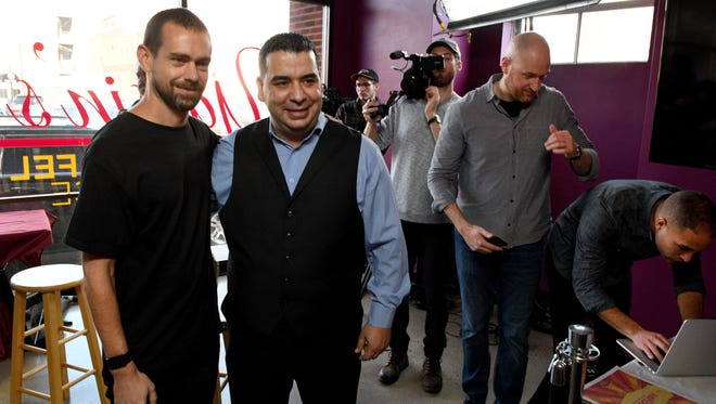 Jack Dorsey, left, CEO of Square and Twitter, poses for a photograph after interviewing Yassin Terou, center, owner of Yassin's Falafel House, as the premier of a short films project on small business successes Thursday, Jan. 26, 2017.