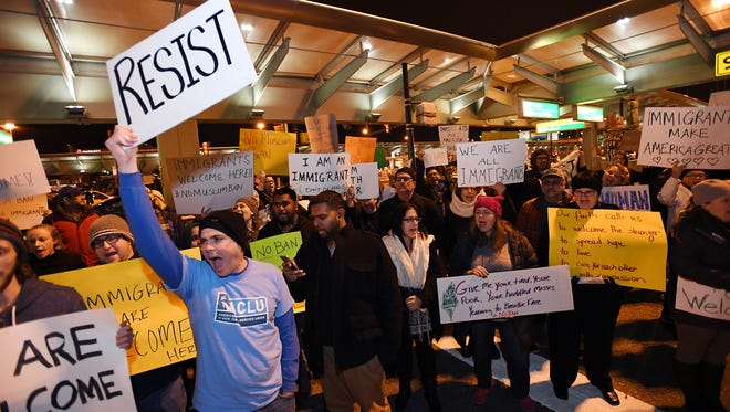 Protesters against President Trump's initial immigration order at Newark Liberty International Airport in January.