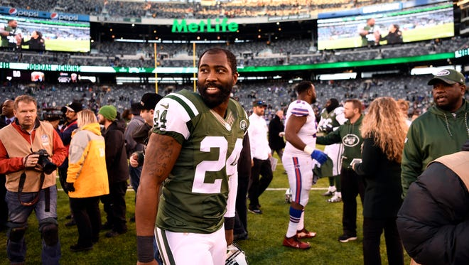 Darrelle Revis, on the field at MetLife Stadium, after his final game as a Jet in January.