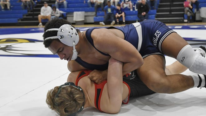 Eastside's Ian Rodgers, top, wrestles Blue Ridge's Shayne Van Wettering in the semifinals of the 160-pound weight class. Rodgers went on to win the championship in Thursday's Region 2-AAAA tournament at Eastside.