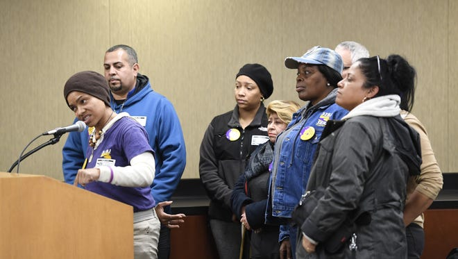 At Tuesday's Port Authority hearing, Nancy Vazquez, vice president and New Jersey state director of 32BJ SEIU, urges the Port Authority to think of improving the work conditions of Newark International Airport employees.