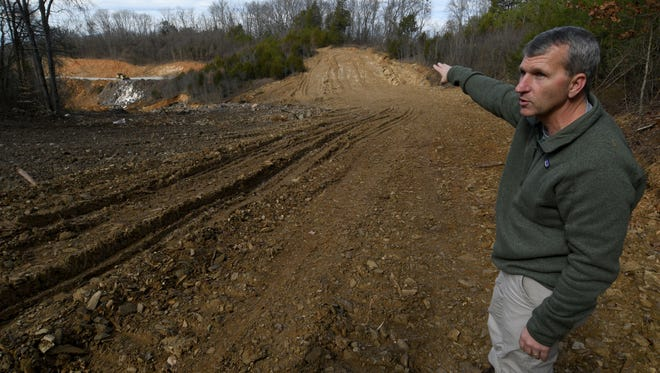 Tom Leonard, director of Sevier Solid Waste Inc. looks over their temporary landfill as he talks Tuesday, Feb. 7, 2017 about their need to build before their new landfill is ready. The current landfill is located on Ridge Rd, in Pigeon Forge.