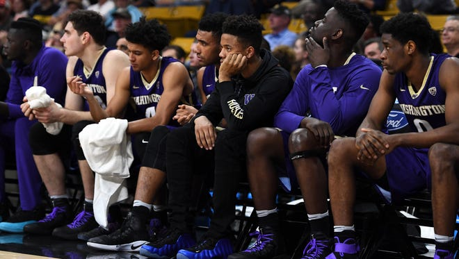 Huskies guard Markelle Fultz (center) sits on the bench in street clothes with a knee injury in UW's 81-66 loss at Colorado.