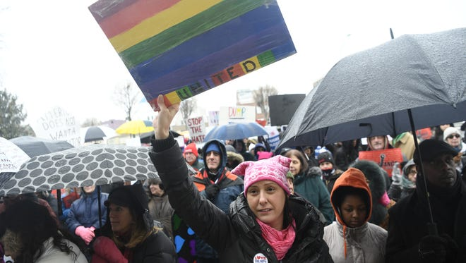 """Sarah Derico, of Wyckoff, and of the group Women for Progress, holding a """"United"""" sign during the Bergen County Unity Rally in which about 150 protesters braved the freezing rain to show support on the steps of the Bergen County Courthouse in Hackensack, NJ on Sunday, February 12, 2017."""