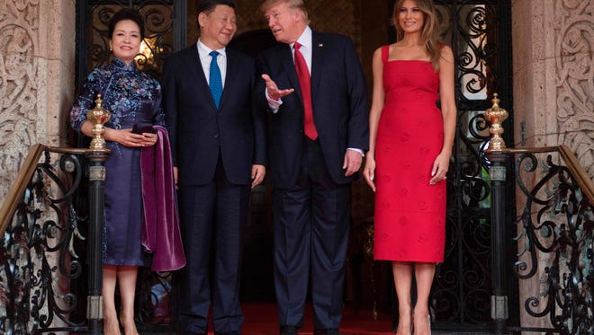 President and Mrs. Trump pose with Chinese President Xi Jinping and his wife Peng Liyuan upon their arrival to the Mar-a-Lago estate in West Palm Beach, Fla. Thursday.