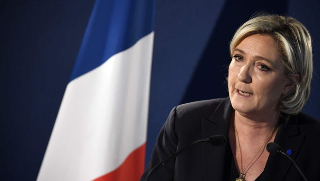 French presidential candidate for the far-right National Front party Marine Le Pen speaks during a news conference April 21 at her campaign headquarters in Paris.