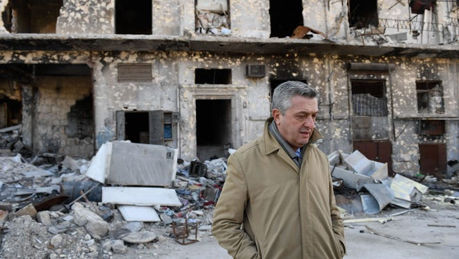"""These ruins speak for themselves. This will weigh heavily on the conscience of the world for generations."" During a visit to Syria, Feb. 1, 2017, United Nations High Commissioner for Refugees Filippo Grandi met displaced people in Aleppo and witnessed the destruction. Here, he walks past badly damaged buildings in Karm Al-Myassar neighborhood in the east of the city."